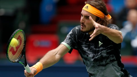 <p>               Stefanos Tsitsipas of Greec hits a return against Felix Auger-Aliassime of Canada during the men's singles match at the Shanghai Masters tennis tournament at Qizhong Forest Sports City Tennis Center in Shanghai, China, Wednesday, Oct. 9, 2019. (AP Photo/Andy Wong)             </p>