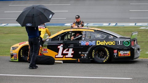 <p>               Clint Bowyer (14) sits in his car during a rain delay in a NASCAR Cup Series auto race at Talladega Superspeedway in Talladega, Ala., Sunday, Oct. 13, 2019. (AP Photo/Butch Dill)             </p>