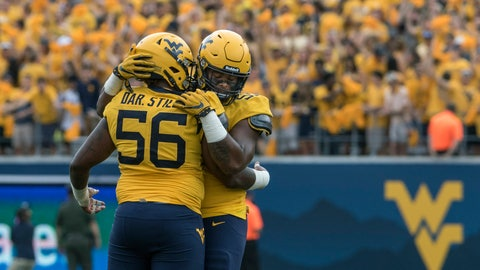 <p>               FILE - In this Sept. 14, 2019, file photo, West Virginia defensive linemen Darius Stills (56) and Dante Stills (55) hug during an NCAA college football game in Morgantown, W.Va. Dante Stills and his older brother, Darius, are among the Big 12's sack leaders and they'll be looking to cause more disruption when West Virginia hosts No. 11 Texas on Saturday. (AP Photo/Raymond Thompson, File)             </p>