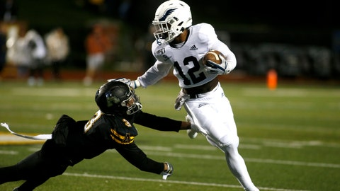 <p>               Georgia Southern running back Wesley Kennedy III (12) gets pressure from Appalachian State defensive back Shaun Jolly (3) during the first half of an NCAA college football game Thursday, Oct. 31, 2019, in Boone, N.C. (AP Photo/Brian Blanco)             </p>