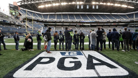 <p>               Fans stand near a logo on the turf at CenturyLink Field honoring former Seattle Seahawks owner Paul G. Allen, who died in 2018, before an NFL football game between the Seahawks and the Los Angeles Rams, Thursday, Oct. 3, 2019, in Seattle. The Seahawks were scheduled to induct Allen into the team's Ring of Honor during a pregame ceremony. (AP Photo/Elaine Thompson)             </p>