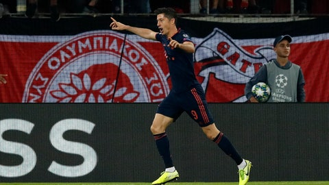<p>               Bayern's Robert Lewandowski celebrates after scoring his side's second goal during the Champions League group B soccer match between Olympiakos and Bayern Munich at the Georgios Karaiskakis stadium, in Piraeus port, near Athens, Tuesday, Oct. 22, 2019. (AP Photo/Thanassis Stavrakis)             </p>