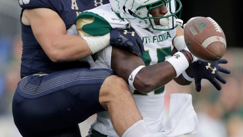 <p>               Navy safety Kevin Brennan, left, breaks up a pass intended for South Florida wide receiver Jernard Phillips during the first half of an NCAA college football game, Saturday, Oct. 19, 2019, in Annapolis. (AP Photo/Julio Cortez)             </p>
