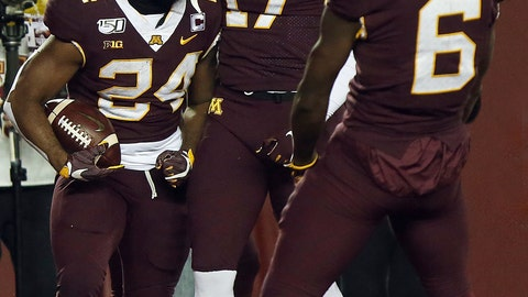 <p>               Minnesota running back Mohamed Ibrahim (24) celebrates with teammates Seth Green (17) and Tyler Johnson (6) after scoring a touchdown against Nebraska during an NCAA college football game Saturday, Oct. 12, 2019, in Minneapolis. (AP Photo/Stacy Bengs)             </p>