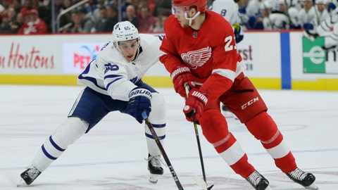 <p>               Toronto Maple Leafs right wing Ilya Mikheyev (65), of Russia, tries to steal the puck from Detroit Red Wings defenseman Dennis Cholowski (21), of the Czech Republic, during the first period of an NHL hockey game, Saturday, Oct. 12, 2019, in Detroit. (AP Photo/Duane Burleson)             </p>