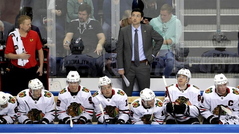 <p>               Chicago's head coach Jeremy Colliton, rear, looks up during a NHL Global Series ice hockey game between Eisbaeren Berlin and Chicago Blackhawks in Berlin, Germany, Sunday, Sept. 29, 2019. (AP Photo/Michael Sohn)             </p>