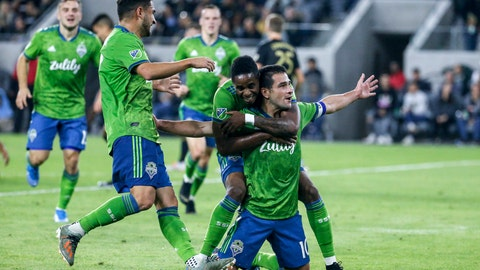 <p>               Seattle Sounders midfielder Nicolas Lodeiro, right, celebrates his goal with teammates during the first half of the MLS soccer Western Conference final against Los Angeles FC, Tuesday, Oct. 29, 2019, in Los Angeles. (AP Photo/Ringo H.W. Chiu)             </p>