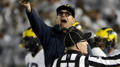 <p>               Michigan coach Jim Harbaugh, center, argues a call during the first half of the team's NCAA college football game against Penn State in State College, Pa., Saturday, Oct. 19, 2019. (AP Photo/Gene J. Puskar)             </p>