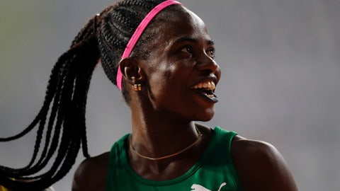 <p>               Tobi Amusan of Nigeria smiles after finishing a women's 100 meter hurdles heat at the World Athletics Championships in Doha, Qatar, Saturday, Oct. 5, 2019. (AP Photo/Petr David Josek)             </p>