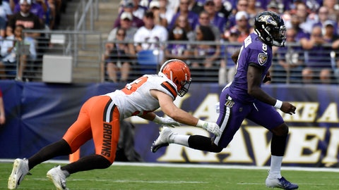 <p>               Baltimore Ravens quarterback Lamar Jackson, right, scrambles as Cleveland Browns middle linebacker Joe Schobert pursues during the first half of an NFL football game Sunday, Sept. 29, 2019, in Baltimore. (AP Photo/Brien Aho)             </p>