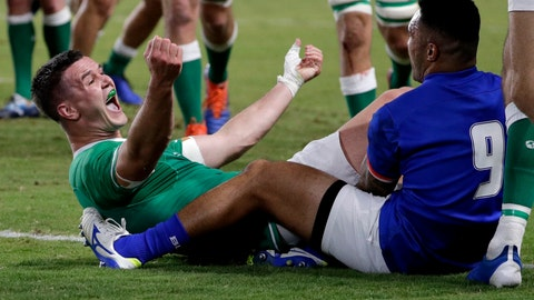 <p>               Ireland's Johnny Sexton celebrates after scoring a try during the Rugby World Cup Pool A game at Fukuoka Hakatanomori Stadium between Ireland and Samoa, in Fukuoka, Japan, Saturday, Oct. 12, 2019. (AP Photo/Aaron Favila)             </p>