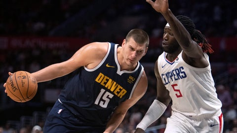 <p>               Denver Nuggets center Nikola Jokic, left, drives toward the basket as Los Angeles Clippers forward Montrezl Harrell defends during the first half of an NBA preseason basketball game in Los Angeles on Thursday, Oct. 10, 2019. (AP Photo/Kyusung Gong)             </p>