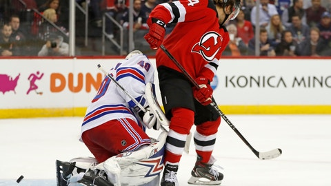 <p>               New Jersey Devils left wing Miles Wood (44) scores a goal on New York Rangers goaltender Alexandar Georgiev (40) during the second period of an NHL hockey game Thursday, Oct. 17, 2019, in Newark, N.J. (AP Photo/Kathy Willens)             </p>
