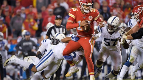 <p>               Kansas City Chiefs quarterback Patrick Mahomes (15) is tackled by Indianapolis Colts defensive end Jabaal Sheard (93) and defensive end Kemoko Turay (57) during the second half of an NFL football game in Kansas City, Mo., Sunday, Oct. 6, 2019. (AP Photo/Reed Hoffmann)             </p>