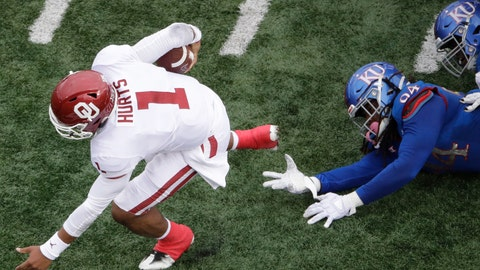 <p>               Oklahoma quarterback Jalen Hurts (1) gets past Kansas defensive end Codey Cole III (94) as he runs the ball during the first half of an NCAA college football game Saturday, Oct. 5, 2019, in Lawrence, Kan. (AP Photo/Charlie Riedel)             </p>