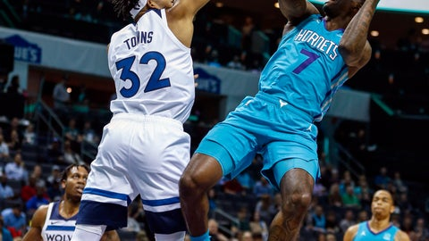 <p>               Charlotte Hornets guard Dwayne Bacon (7) shoots against Minnesota Timberwolves center Karl-Anthony Towns (32) in the first half of an NBA basketball game in Charlotte, N.C., Friday, Oct. 25, 2019. (AP Photo/Nell Redmond)             </p>