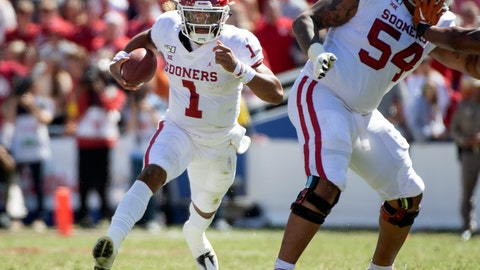 <p>               Oklahoma quarterback Jalen Hurts (1) runs against Texas behind the block of offensive lineman Marquis Hayes (54) in the second half of an NCAA college football game at the Cotton Bowl, Saturday, Oct. 12, 2019, in Dallas. Oklahoma won 34-27. (AP Photo/Jeffrey McWhorter)             </p>