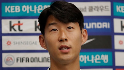 <p>               South Korean national soccer team player Son Heung-min answers a reporter's question upon his arrival after the soccer match against North Korea, at Incheon International Airport in Incheon, South Korea, Thursday, Oct. 17, 2019. North Korea held South Korea to a 0-0 draw Tuesday in a World Cup qualifying soccer match played in an empty stadium in Pyongyang, but specific details of the game weren't immediately available. South Korean soccer officials were unable to watch a telecast of the historic game at Kim Il Sung Stadium and South Korean spectators and media were denied entry. (AP Photo/Lee Jin-man)             </p>