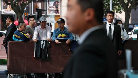 <p>               Chinese security officers stand guard as fans carrying jerseys and shoes wait for NBA players to autograph outside the Ritz-Carlton hotel in Shanghai, China, Thursday, Oct. 10, 2019. NBA Commissioner Adam Silver told the Brooklyn Nets and Los Angeles Lakers on Wednesday that the league is still expecting them to play as scheduled this week, even while the rift between the league and Chinese officials continued in ways that clearly suggested the two planned games in Shanghai and Shenzhen were anything but guaranteed. (AP Photo/Andy Wong)             </p>