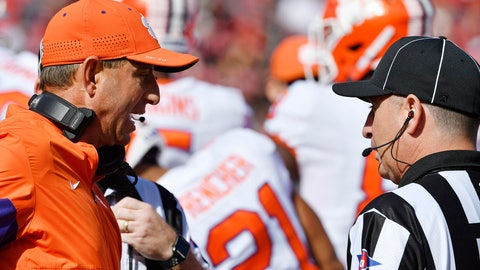 <p>               Clemson head coach Dabo Swinney, left, argues with a game official during the first half of an NCAA college football game against Louisville in Louisville, Ky., Saturday, Oct. 19, 2019. (AP Photo/Timothy D. Easley)             </p>