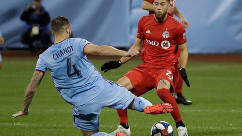 <p>               New York City FC's Maxime Chanot (4) fights for control of the ball with Toronto FC's Jonathan Osorio (21)during the first half of an MLS Eastern Conference semifinal soccer match Wednesday, Oct. 23, 2019, in New York. (AP Photo/Frank Franklin II)             </p>