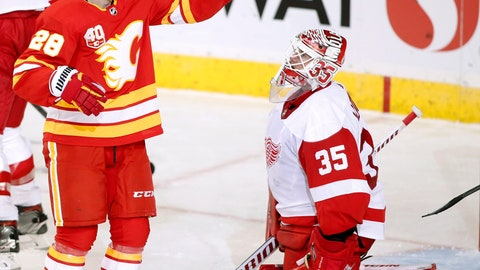 <p>               Calgary Flames center Elias Lindholm (28) celebrates his goal in front of Detroit Red Wings goalie Jimmy Howard (35) during second-period NHL hockey action in Calgary, Alberta, Thursday, Oct. 17, 2019.  (Larry MacDougal/The Canadian Press via AP)             </p>