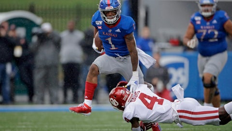 <p>               Kansas running back Pooka Williams Jr. (1) is tackled by Oklahoma cornerback Jaden Davis (4) during the first half of an NCAA college football game Saturday, Oct. 5, 2019, in Lawrence, Kan. (AP Photo/Charlie Riedel)             </p>