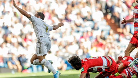 <p>               Real Madrid's Eden Hazard celebrates after scoring during the Spanish La Liga soccer match between Real Madrid and Granada at the Santiago Bernarbeu stadium in Madrid, Saturday, Oct. 5, 2019. (AP Photo/Bernat Armangue)             </p>