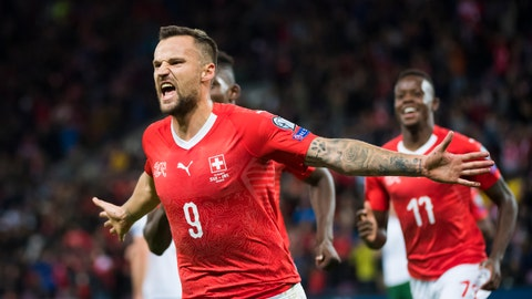 <p>               Switzerland's forward Haris Seferovic, celebrates after scoring the first goal of the game against Republic of Ireland, during their Euro 2020 qualifying Group D soccer match at the Stade de Geneve, in Geneva, Switzerland, Tuesday, Oct. 15, 2019. (Jean-Christophe Bott/Keystone via AP)             </p>