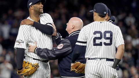 <p>               New York Yankees trainer Steve Donohue, center, checks on pitcher CC Sabathia during the eighth inning of Game 4 of baseball's American League Championship Series against the Houston Astros, Thursday, Oct. 17, 2019, in New York. (AP Photo/Frank Franklin II)             </p>