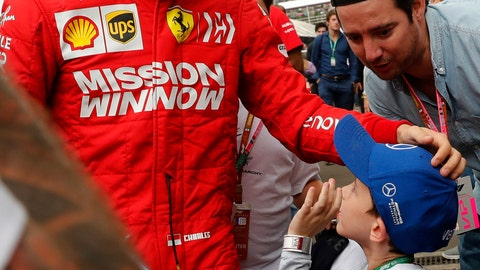 <p>               Ferrari driver Charles Leclerc, of Monaco, acknowledges a young fan during a training session of the Formula One Mexico Grand Prix auto race at the Hermanos Rodriguez racetrack in Mexico City, Friday, Oct. 25, 2019. (AP Photo/Marco Ugarte)             </p>
