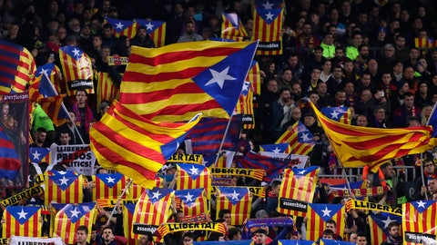 """<p>               FILE - In this Feb. 6, 2019 file photo, Barcelona supporters wave Estelada or pro-independence flags during the Copa del Rey semifinal first leg soccer match between FC Barcelona and Real Madrid at the Camp Nou stadium in Barcelona, Spain. Next week's """"clásico"""" between Barcelona and Real Madrid, due to be played on Oct. 26, 2019, has been postponed by the Spanish soccer federation to avoid coinciding with a large separatist rally in riot-stricken Catalonia. (AP Photo/Manu Fernandez, File)             </p>"""