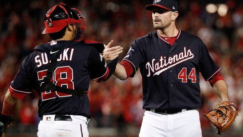 <p>               Washington Nationals relief pitcher Daniel Hudson (44) and catcher Kurt Suzuki (28) celebrate the final of Game 4 of a baseball National League Division Series against the Los Angeles Dodgers, Monday, Oct. 7, 2019, in Washington. (AP Photo/Alex Brandon)             </p>