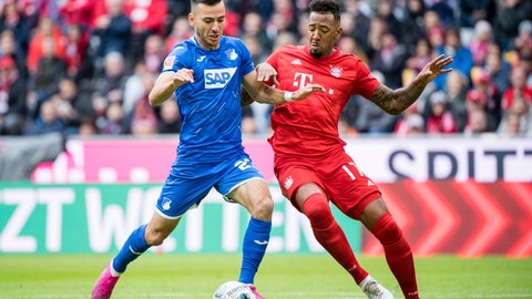 <p>               Hoffenheim's Sargis Adamyan, left, and Bayern's Jerome Boateng, right, challenge for the ball during the German Bundesliga soccer match between FC Bayern Munich and 1899 Hoffenheim in Munich, Germany, Saturday, Oct. 5, 2019. (Matthias Balk/dpa via AP)             </p>