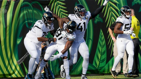 <p>               Jacksonville Jaguars defensive end Yannick Ngakoue (91) celebrates his interception and touchdown run in the second half of an NFL football game against the Cincinnati Bengals, Sunday, Oct. 20, 2019, in Cincinnati. (AP Photo/Frank Victores)             </p>