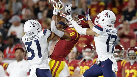 <p>               Arizona safety Tristan Cooper (31) and cornerback Jace Whittaker (17) break up a pass intended for Southern California wide receiver Amon-Ra St. Brown (8) during the first half of an NCAA college football game Saturday, Oct. 19, 2019, in Los Angeles. (AP Photo/Marcio Jose Sanchez)             </p>