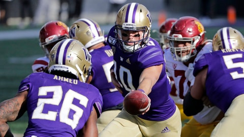 <p>               Washington quarterback Jacob Eason (10) hands-off to Salvon Ahmed against Southern Cal in the second half of an NCAA college football game Saturday, Sept. 28, 2019, in Seattle. Washington won 28-14. (AP Photo/Elaine Thompson)             </p>