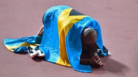 <p>               Gold medallist Steven Gardiner, of Bahamas, celebrates winning the men's 400 meter at the World Athletics Championships in Doha, Qatar, Friday, Oct. 4, 2019. (AP Photo/Martin Meissner)             </p>