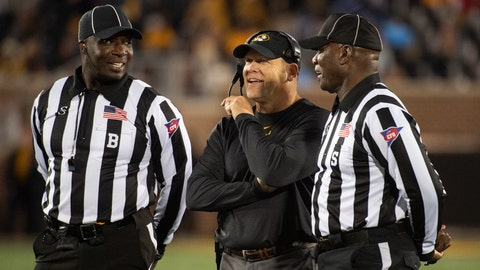 <p>               Missouri head coach Barry Odom, center, laughs while talking with referees during the second quarter of an NCAA college football game against Mississippi Saturday, Oct. 12, 2019, in Columbia, Mo. (AP Photo/L.G. Patterson)             </p>