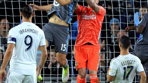 <p>               LA Galaxy goalkeeper David Bingham (1) deflects a header by Minnesota United defender Michael Boxall (15) during the first half of an MLS soccer first-round playoff match, Sunday, Oct. 20, 2019, in St. Paul, Minn. (AP Photo/Andy Clayton-King)             </p>