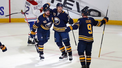 <p>               Buffalo Sabres forwards Marcus Johansson (90), Sam Reinhart (23) and Jack Eichel (9) celebrate a goal by Johansson during overtime in the team's NHL hockey game against the Montreal Canadiens, Wednesday, Oct. 9, 2019, in Buffalo, N.Y. (AP Photo/Jeffrey T. Barnes)             </p>