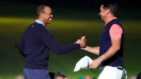 <p>               Tiger Woods of the United States, left, and Jason Day of Australia, right, hold their hands on the 18th hole after the Challenge: Japan Skins event ahead of the Zozo Championship PGA Tour at Accordia Golf Narashino C.C. in Inzai, east of Tokyo, Monday, Oct. 21, 2019. (AP Photo/Lee Jin-man)             </p>