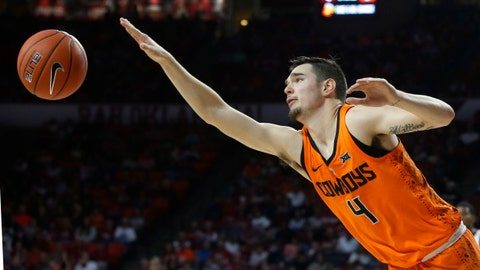 <p>               FILE - In this Jan. 5, 2019 file photo, Oklahoma State guard Thomas Dziagwa (4) reaches for the ball during an NCAA college basketball game against Oklahoma in Norman, Okla. The Cowboys have a trio of senior captains who are primed to lead the Cowboys back to prominence - Lindy Waters III, Cameron McGriff and Thomas Dziagwa. (AP Photo/Sue Ogrocki, File)             </p>