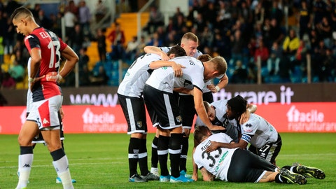<p>               Parma's Jurai Kucka, third from right on the ground, celebrates after scoring during a Serie A soccer match between Parma and Genoa at the Ennio Tardini stadium in Parma, Italy, Sunday, Oct. 20, 2019. (Serena Campanini/ANSA via AP)             </p>
