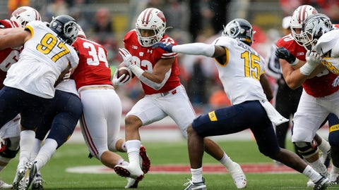<p>               Wisconsin running back Jonathan Taylor (23) runs against Kent State cornerback Keith Sherald Jr. (15) during the first half of an NCAA college football game Saturday, Oct. 5, 2019, in Madison, Wis. (AP Photo/Andy Manis)             </p>