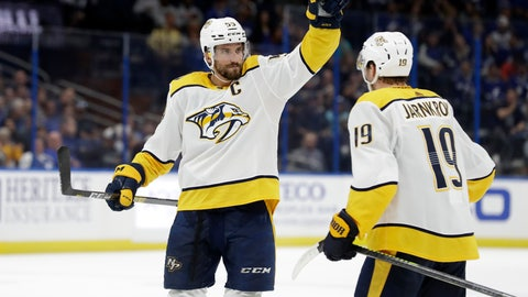 <p>               Nashville Predators defenseman Roman Josi (59) celebrates his goal against the Tampa Bay Lightning with center Calle Jarnkrok (19) during the third period of an NHL hockey game Saturday, Oct. 26, 2019, in Tampa, Fla. (AP Photo/Chris O'Meara)             </p>