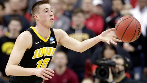 <p>               FILE-  In this March 22, 2019, file photo, Iowa's Joe Wieskamp passes the ball against Cincinnati in the second half during a first-round men's college basketball game in the NCAA Tournament in Columbus, Ohio, Friday,. Returning starters Joe Wieskamp and Luka Garza headline a roster that is deep at every position. (AP Photo/Tony Dejak, File)             </p>