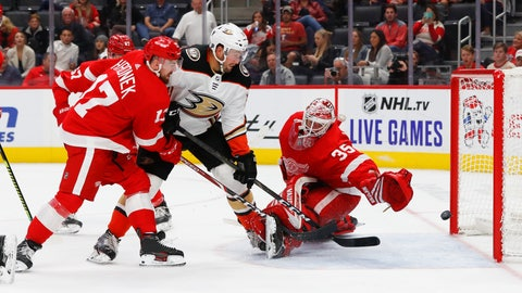 <p>               Anaheim Ducks left wing Nick Ritchie (37) scores on Detroit Red Wings goaltender Jimmy Howard (35) as defenseman Filip Hronek (17) defends in the third period of an NHL hockey game, Tuesday, Oct. 8, 2019, in Detroit. (AP Photo/Paul Sancya)             </p>