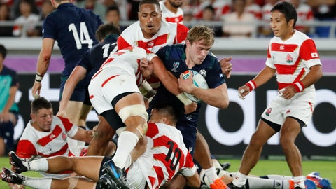 <p>               Scotland's Jonny Gray is tacked by Japan's defense during the Rugby World Cup Pool A game at International Stadium between Japan and Scotland in Yokohama, Japan, Sunday, Oct. 13, 2019. (AP Photo/Eugene Hoshiko)             </p>