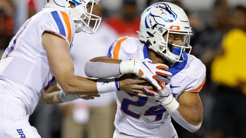 <p>               Boise State quarterback Chase Cord hands the ball to running back George Holani during the first half of an NCAA college football game against UNLV, Saturday, Oct. 5, 2019, in Las Vegas. (AP Photo/John Locher)             </p>